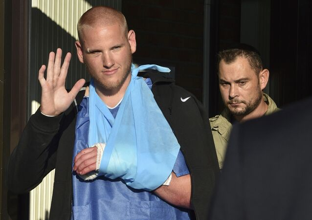 U.S. serviceman Spencer Stone waves as he departs the Clinique Lille Sud, which specializes in hand injuries, in Lesquin, France, in an August 22, 2015 file photo