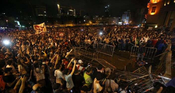 Lebanese anti-government protesters remove barriers that blocked a road linked to the parliament building, during a protest against the ongoing trash crisis and government corruption, in Beirut, Lebanon, on Thursday, Oct. 8, 2015. Lebanese security forces used water cannons and eventually fired tear gas canisters to disperse some dozens of anti-government protesters who tried to get past security barricades and reach parliament.