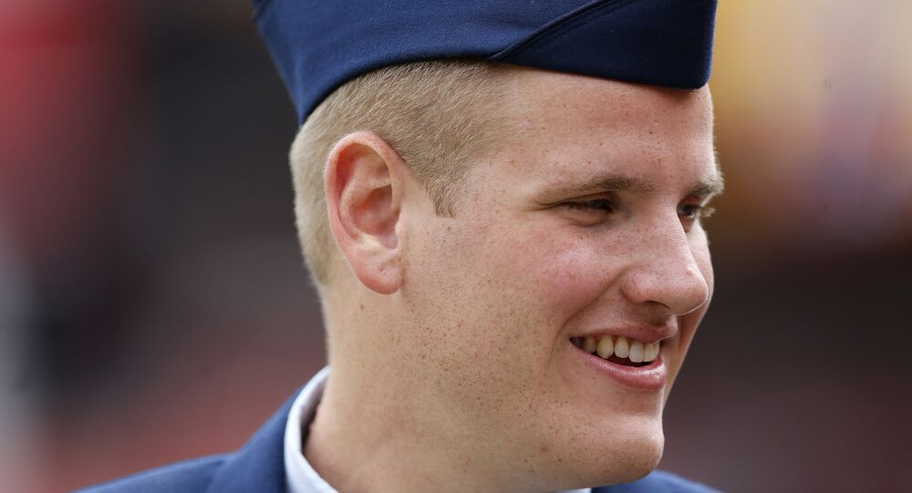 In this Sept. 20, 2015 file photo, US Air Force Airman 1st Class Spencer Stone walks along the sidelines before an NFL football game in Landover, Md. An Air Force spokesman said Thursday, Oct. 8, 2015, that Stone, who helped subdue an attacker on a Paris-bound train in August, is in stable condition after being stabbed in California.