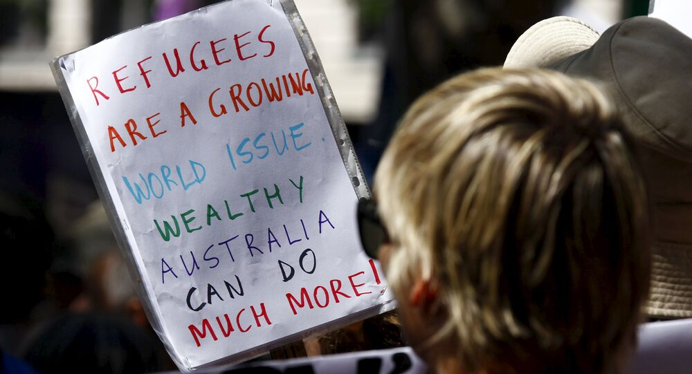 Protesters hold placards at the 'Stand up for Refugees' rally held in central Sydney. Australia is negotiating a deal with the Philippines to transfer asylum seekers being held indefinitely in controversial detention centres on remote, impoverished islands, Australia's immigration minister said on October 9, 2015