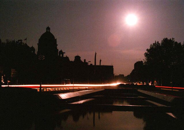 The dome of the Yugoslav Parliament building in downtown Belgrade is lit by moonlight after NATO jets hit power plants in Serbia during air raids early Monday May 3, 1999 plunging most of the country into darkness. Power was restored before dawn primarily to the hospitals, water supply services and bakeries