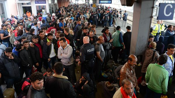File Photo: Refugees wait for a special train at the train station in Freilassing, near the Austrian-German border, southern Germany - Sputnik International
