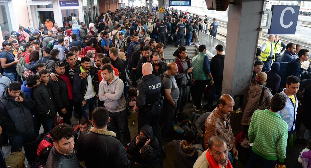 Refugees wait for a special train at the train station in Freilassing, near the Austrian-German border, southern Germany, on September 15, 2015
