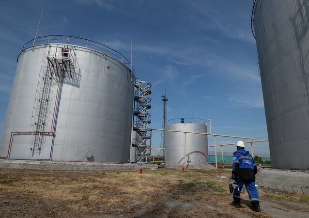 An employee of Gazprom-Neft's Novosibirsk petroleum base near fuel storage tanks