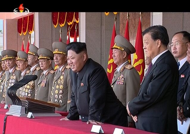 In this image made from video, North Korean leader Kim Jong Un, center, along with Liu Yunshan, China's Communist Party's No. 5 leader, third right, watches parade during the ceremony to mark the 70th anniversary of the country's ruling party in Pyongyang, Saturday, Oct. 10, 2015