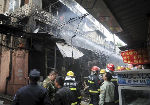 Firefighters try to extinguish a fire after an explosion at a restaurant in Wuhu, Anhui province, China, October 10, 2015