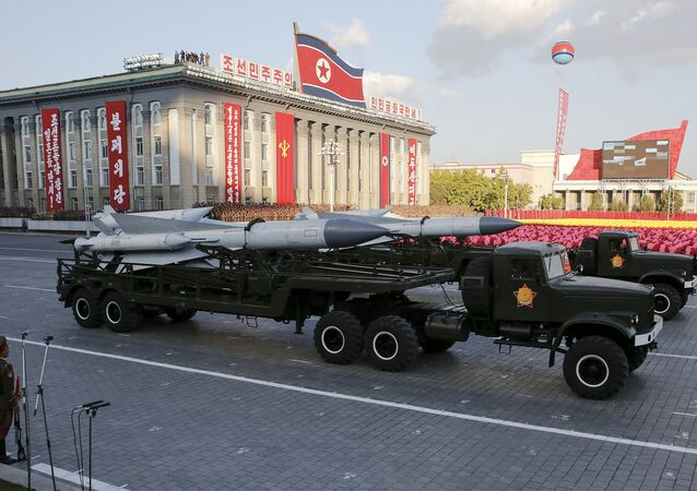 Missiles are taken on trucks past a stand with North Korean leader Kim Jong Un during the parade celebrating the 70th anniversary of the founding of the ruling Workers' Party of Korea, in Pyongyang October 10, 2015