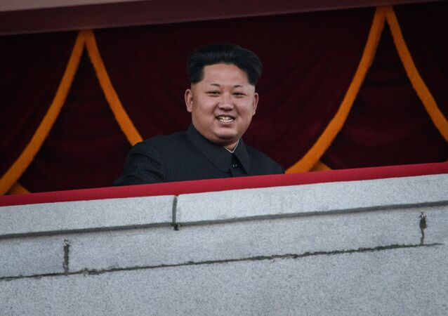 North Korea's leader Kim Jong-un looks out towards Kim Il-Sung square.