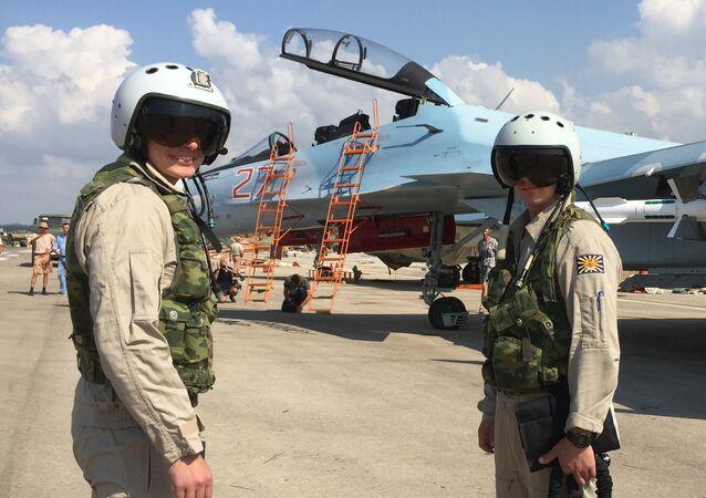Russian pilots prepared to board the SU-30 attack plane to take off from the Hmeimim aerodrome in Syria.