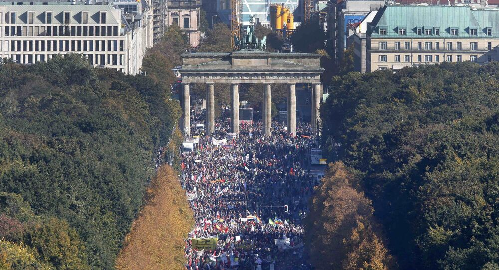 Consumer rights activists take part in a march to protest against the Transatlantic Trade and Investment Partnership (TTIP), mass husbandry and genetic engineering, in Berlin, Germany, October 10, 2015