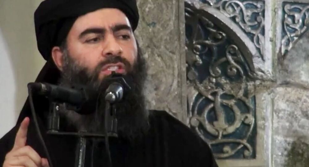 Eader of the Islamic State group, Abu Bakr al-Baghdadi, delivering a sermon at a mosque in Iraq