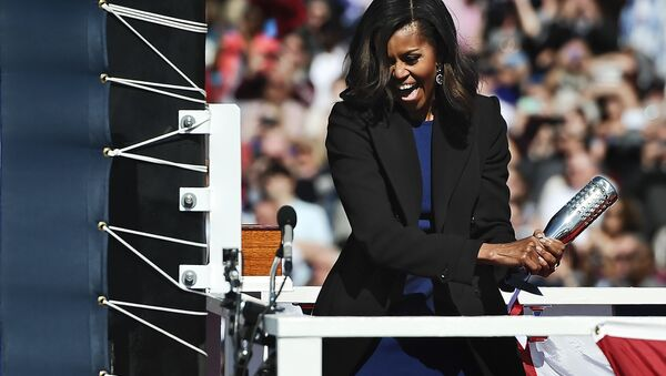 Michelle Obama at solemn ceremony of launching a new Navy submarine at a shipyard in Connecticut. - Sputnik International