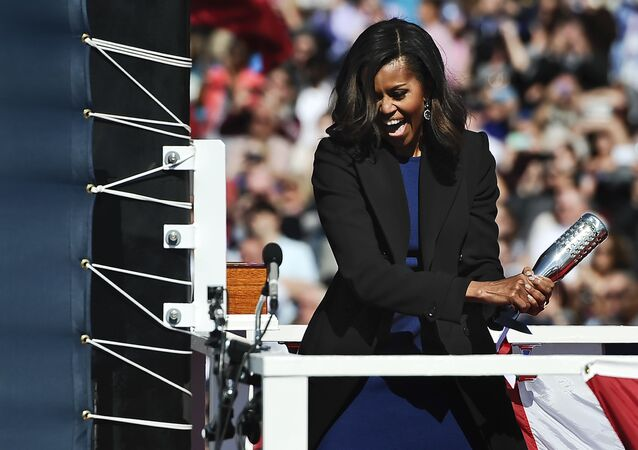 Michelle Obama at solemn ceremony of launching a new Navy submarine at a shipyard in Connecticut.