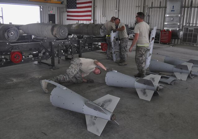 US Air Force munitions team assemble guided bombs