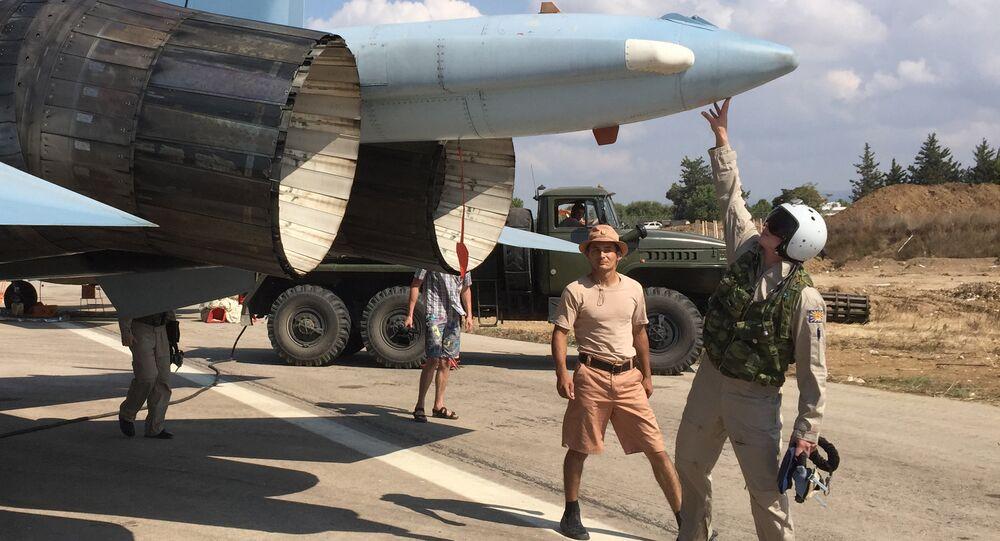 Russian pilots ready a Su-30 fighter for a raid at Hmeimim aerodrome in Syria.