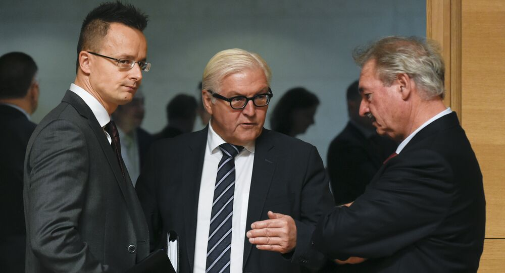 (LtoR) Hungary's Foreign Minister Janos Martonyi talks with German Foreign Minister Frank-Walter Steinmeier and Luxembourg's Foreign Minister Jean Asselborn during a EU Foreign Affairs Council meeting in Luxembourg on October 12, 2015. AFP PHOTO / JOHN THYS