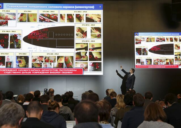Journalists attend a news conference, organized by officials of Russian missile manufacturer Almaz-Antey and dedicated to the results of its investigation into Malaysia Airlines flight MH17 crash in eastern Ukraine, in Moscow, Russia, October 13, 2015