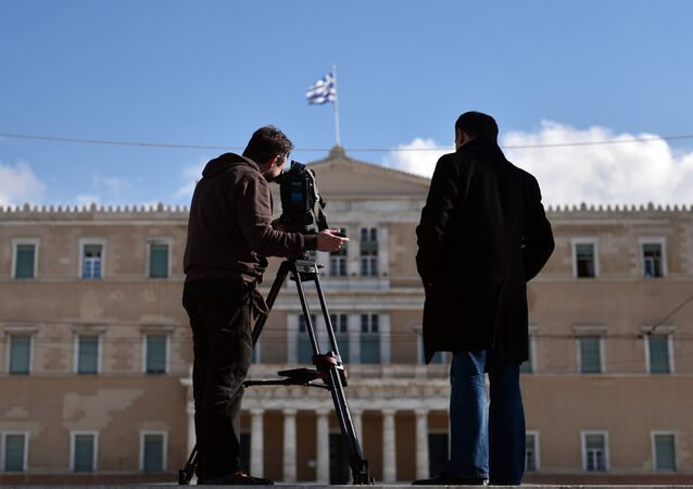 Foreign media film the greek parliament in Athens on January 26, 2015