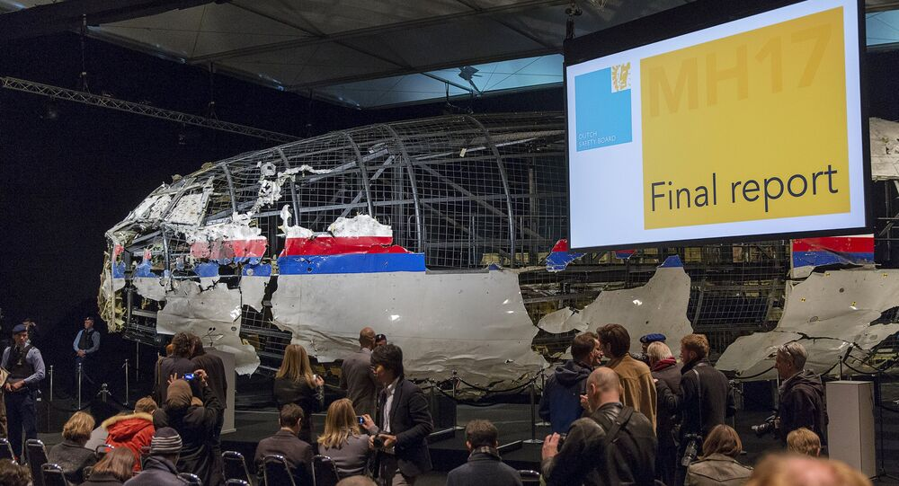The reconstructed airplane serves as a backdrop during the presentation of the final report into the crash of July 2014 of Malaysia Airlines flight MH17 over Ukraine, in Gilze Rijen, the Netherlands, October 13, 2015