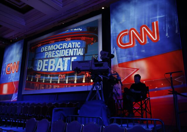A camera operator waits in the debate hall before a CNN Democratic presidential debate.