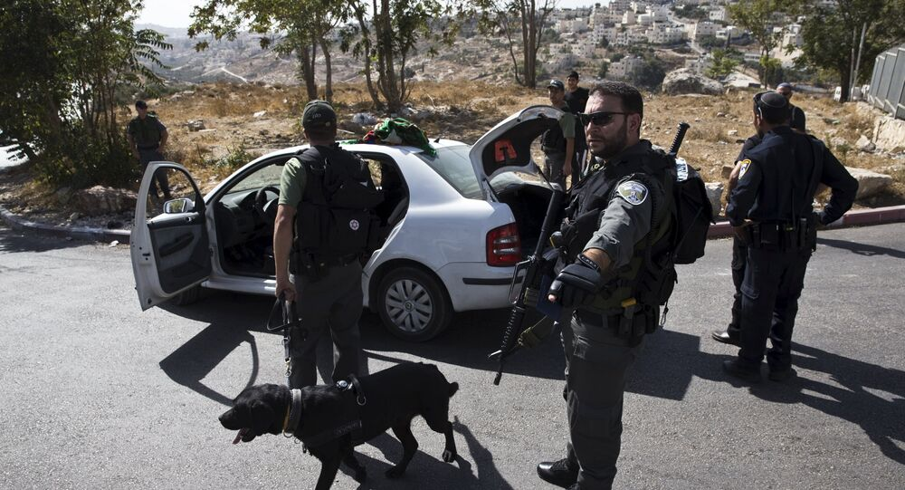 Israeli border policemen check a Palestinian car at a checkpoint in Jabel Mukaber, in an area of the West Bank that Israel captured in a 1967 war and annexed to the city of Jerusalem October 14, 2015