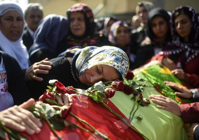 Relatives mourn near the coffin of a victim of the twin bombings in Ankara, during the funeral in Istanbul on October 12, 2015