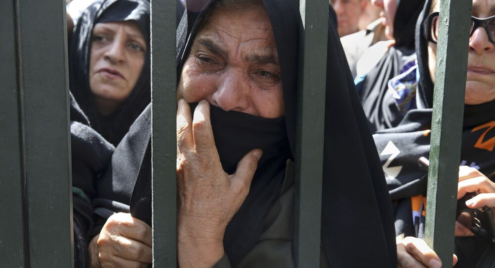 An Iranian mourner weeps during a funeral ceremony, attended by thousands of mourners in Tehran, Iran, for some of the pilgrims who were killed in a stampede during the hajj pilgrimage in Saudi Arabia in September 2015.
