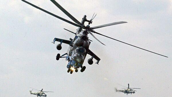 Mi-24 helicopter gunships of Berkuty (Golden Eagles) Russian aerobatic team perform during the Flying Legend. - Sputnik International