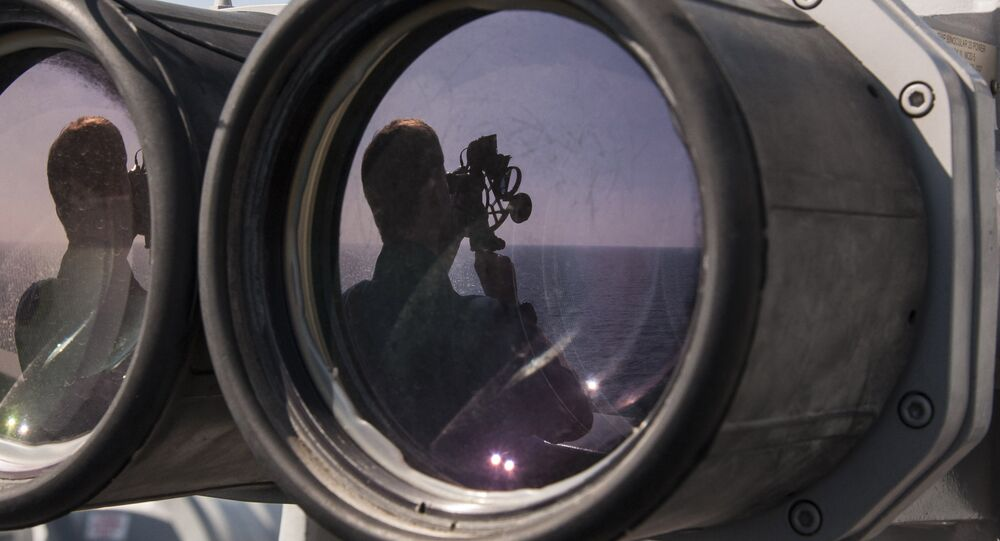Quartermaster 2nd Class Scott Loydon, from St. Petersburg, Fla., uses a sextant to chart the course of the amphibious transport dock ship USS New Orleans (LPD 18).