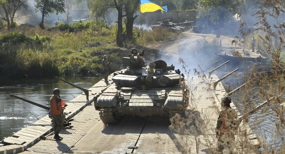 Tanks of the Ukrainian armed forces make a crossing during a withdrawal near the village of Nyzhnje in Luhansk region, Ukraine, October 5, 2015