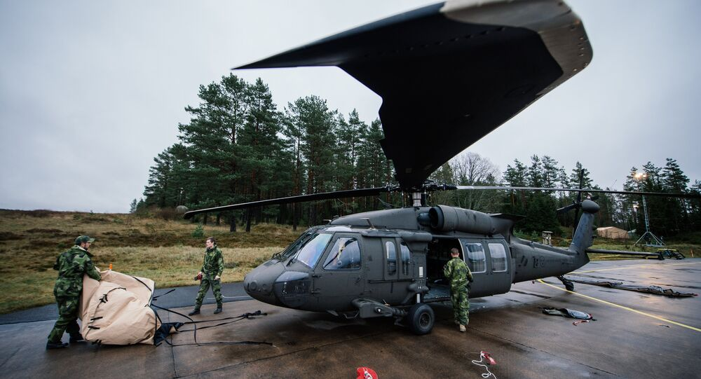 Soldiers from the Swedish Armed Forces prepare an Blackhawk helicopter at Hagshult Airbase, part of the Forward Operation Base of the NBG (Nordic Battlegroup), about 240km North-East of Malmo, Sweden on 6 November 2014