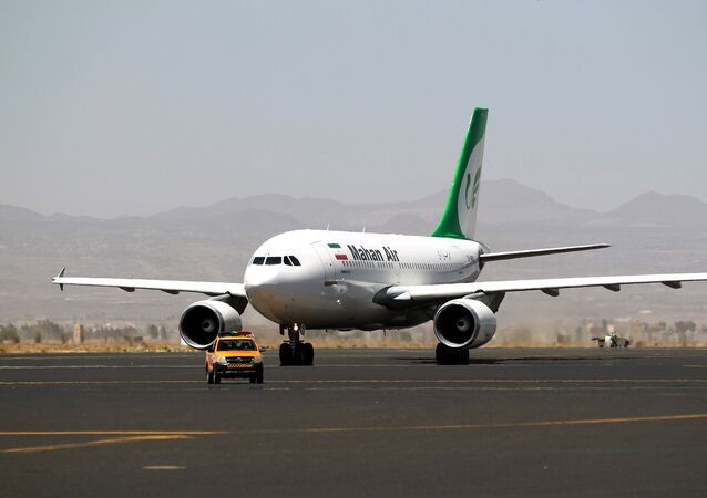 An airplane of Mahan Air sits at the tarmac after landing at Sanaa International Airport in the Yemeni capital on March 1, 2015