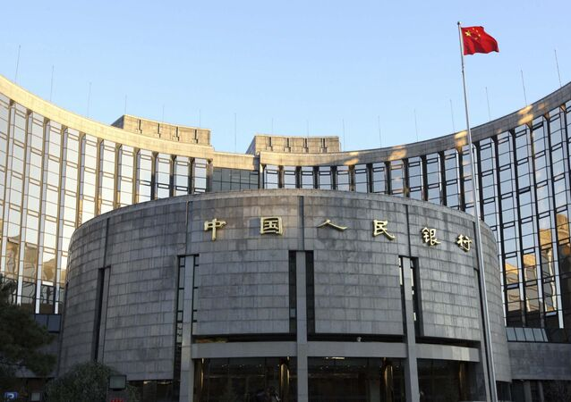 In this Nov. 27, 2008, file photo released by China's Xinhua News Agency, a Chinese flag flutters in front of the headquarters of the People's Bank of China (PBOC) in Beijing