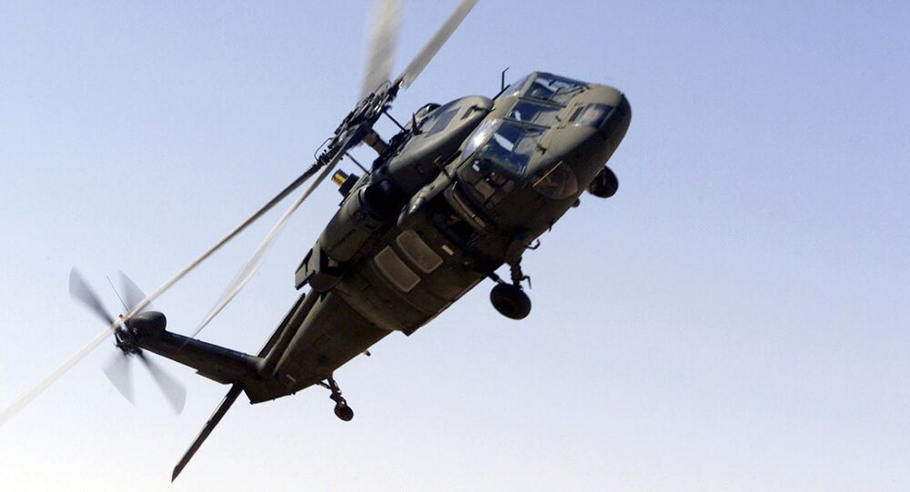 A picture taken 30 October 2000 shows an UH-60 Blackhawk helicopter flying near the Prince Sultan Air Base, Saudi Arabia.