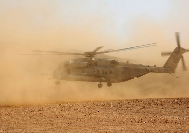 A CH-53E Super Stallion lands in the desert of Djibouti.