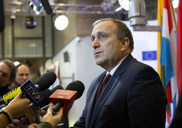 Polish Foreign Minister Grzegorz Schetyna speaks with the media prior to a meeting of EU foreign ministers at the EU Council building in Brussels on Thursday, Jan. 29, 2015