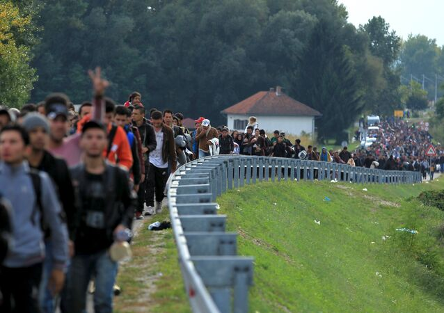 Migrants walk towards the Hungarian border after arriving at the train station in Botovo, Croatia October 6, 2015