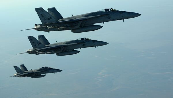 This US Air Forces Central Command file photo released by the Defense Video & Imagery Distribution System (DVIDS) shows a formation of US Navy F-18E Super Hornets in flight after receiving fuel from a KC-135 Stratotanker over northern Iraq, on September 23, 2014 - Sputnik International