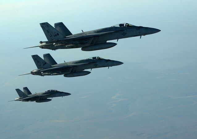 This US Air Forces Central Command file photo released by the Defense Video & Imagery Distribution System (DVIDS) shows a formation of US Navy F-18E Super Hornets in flight after receiving fuel from a KC-135 Stratotanker over northern Iraq, on September 23, 2014