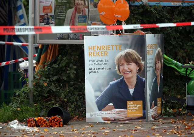 Election posters of independent candidate for the mayor of Cologne Henriette Reker stand behind a police barrier in Cologne, Germany, Saturday, Oct. 17, 2015.