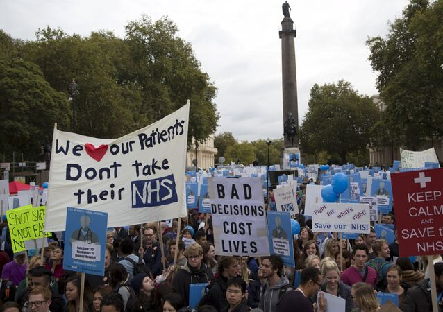 Protesters hold banners at a demonstration in support of junior doctors in London, Britain October 17, 2015.