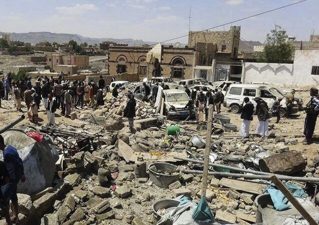 People gather at the site of Saudi-led airstrikes in Sanban, a region in Dhamar province 113 km (70 miles) southeast of the capital, Sanaa, Yemen, Thursday, Oct. 8, 2015.