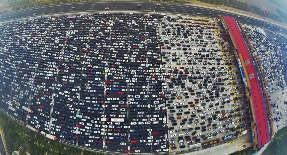 Vehicles are seen stuck in a traffic jam near a toll station as people return home at the end of a week-long national day holiday, in Beijing, China, October 6, 2015