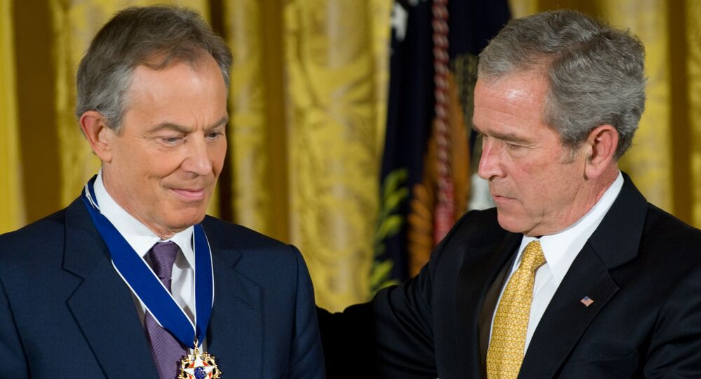 US President George W. Bush presents the Presidential Medal of Freedom to former British Prime Minister Tony Blair (L) in the East Room of the White House in Washington. (File)