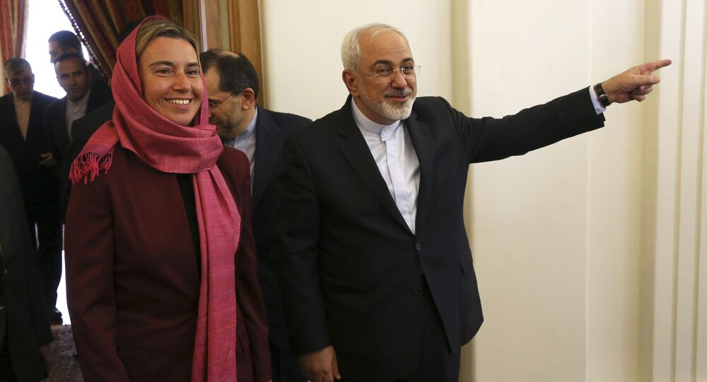 Iranian Foreign Minister Mohammad Javad Zarif, right, gestures with European Union foreign policy chief Federica Mogherini.