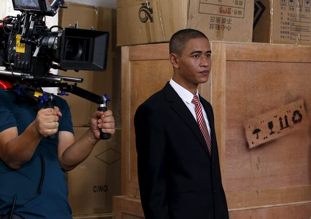Xiao Jiguo, a 29-year-old actor from China's Sichuan province who impersonates U.S. President Barack Obama, prepares to act at a film site in the southern Chinese city of Guangzhou September 18, 2015.