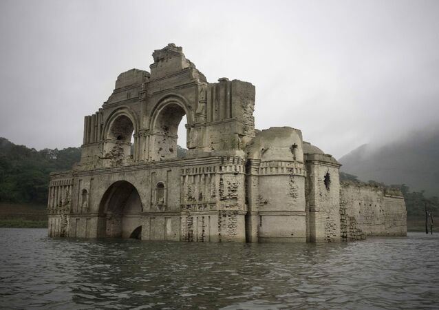 The remains of a mid-16th century church known as the Temple of Santiago, as well as the Temple of Quechula, is visible from the surface of the Grijalva River, which feeds the Nezahualcoyotl reservoir, due to the lack of rain near the town of Nueva Quechula, in Chiapas state, Mexico, Friday, Oct. 16, 2015.