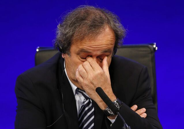In this May 24, 2013 file photo UEFA President Michel Platini reacts as he speaks to members of the media at the end of the 37th Ordinary UEFA Congress in London.