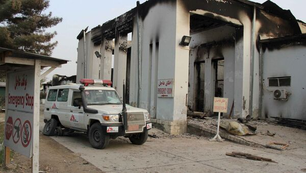 A vehicle is parked in front of a damaged building at Medecins Sans Frontieres (MSF) in Kunduz, Afghanistan October 16, 2015. - Sputnik International