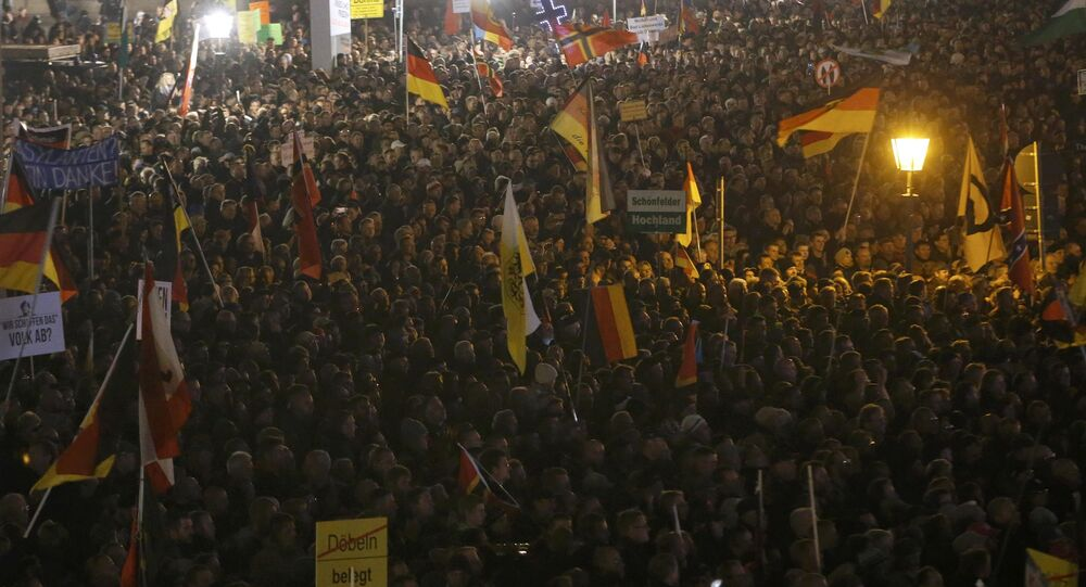 People gather for an anti-immigration demonstration organised by rightwing movement Patriotic Europeans Against the Islamisation of the West (PEGIDA) in Dresden, Germany October 19, 2015.